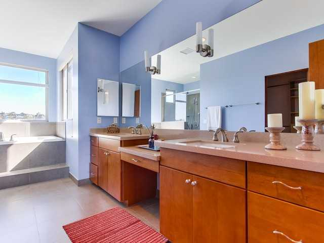Large Master Suite with jacuzzi bath and two walk-in closets with laundry chute